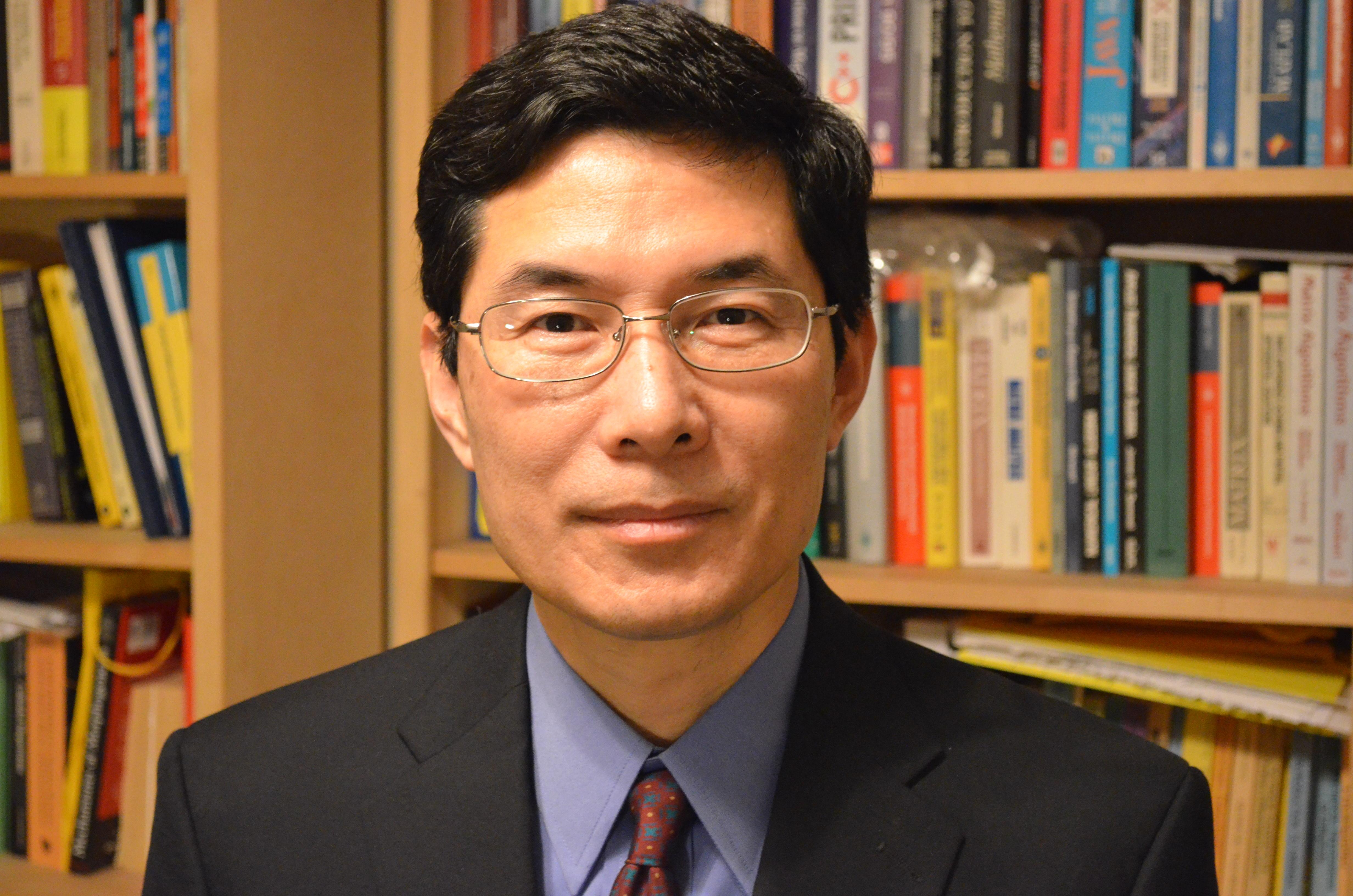 http://www.math.sc.edu/~qwang/2012-portrait.JPG
